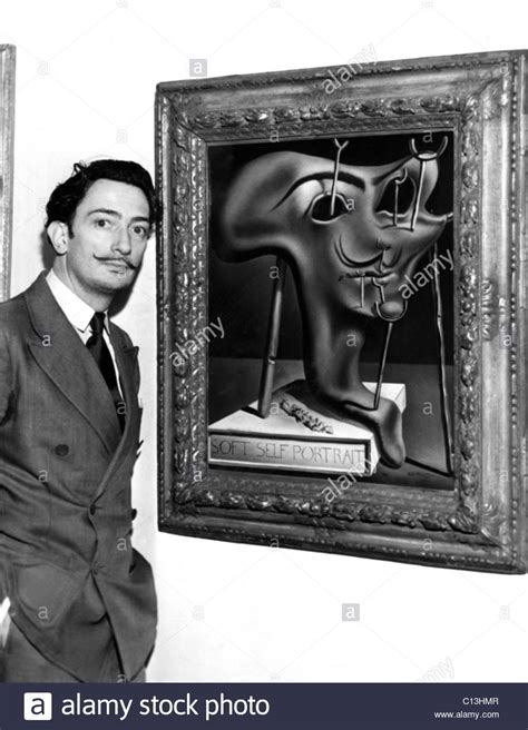 Salvador Dali, showing off his piece entitled 'Soft Self